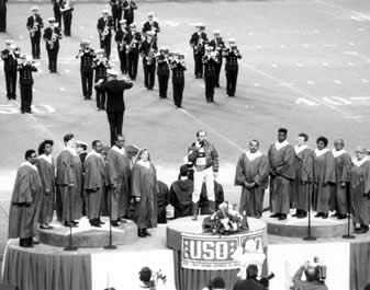 3780ec3a651 The Naval Academy Band accompanies Mr. Lee Greenwood in his hit song